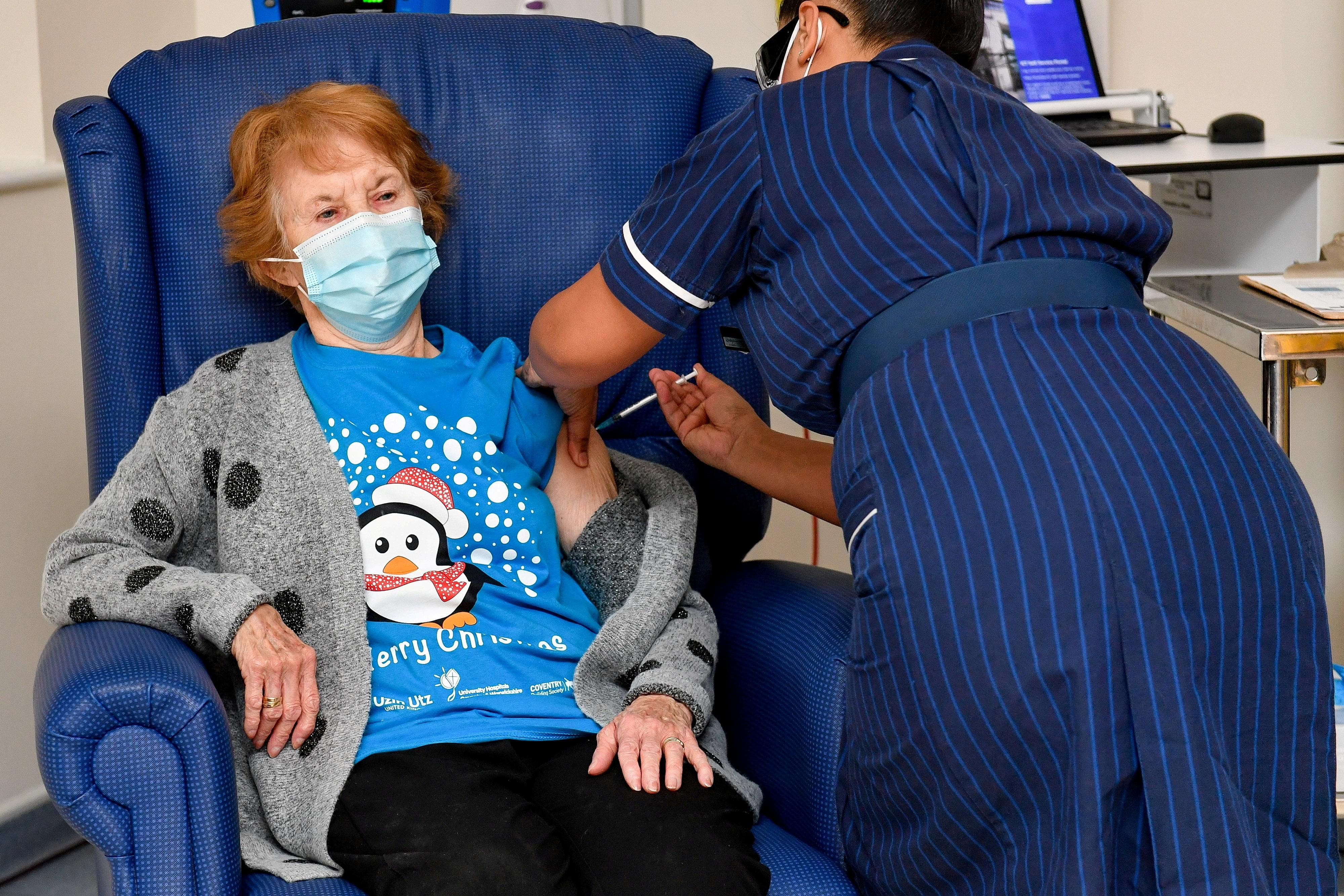 Margaret Keenan, 90, is the first patient in Britain to receive the Pfizer/BioNtech COVID-19 vaccine at University Hospital, administered by nurse May Parsons, at the start of the largest ever immunization program in British history, in Coventry.