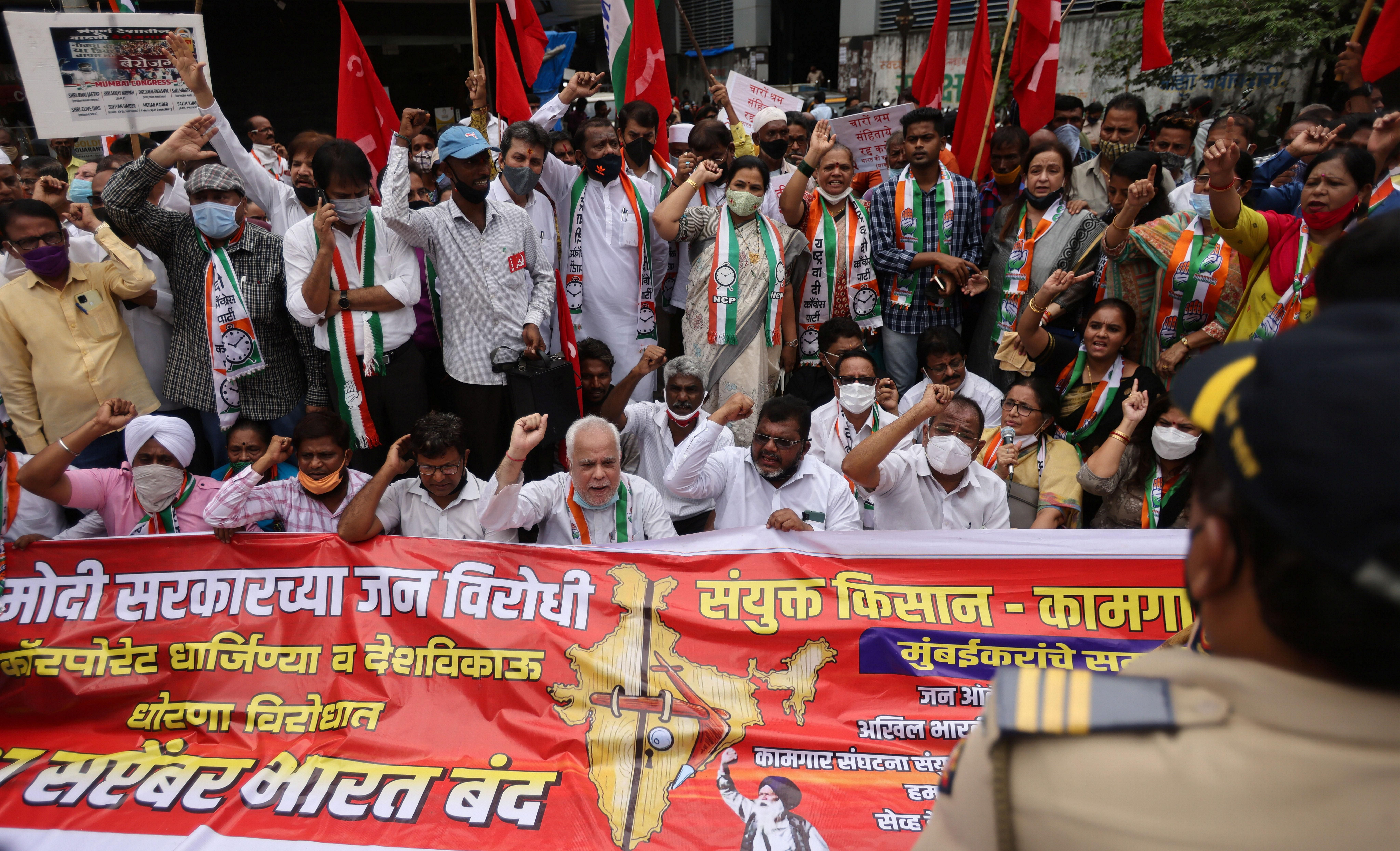 Members of the Communist Party of India (CPI) protest against farm laws during a nationwide strike, in Mumbai, India, September 27, 2021