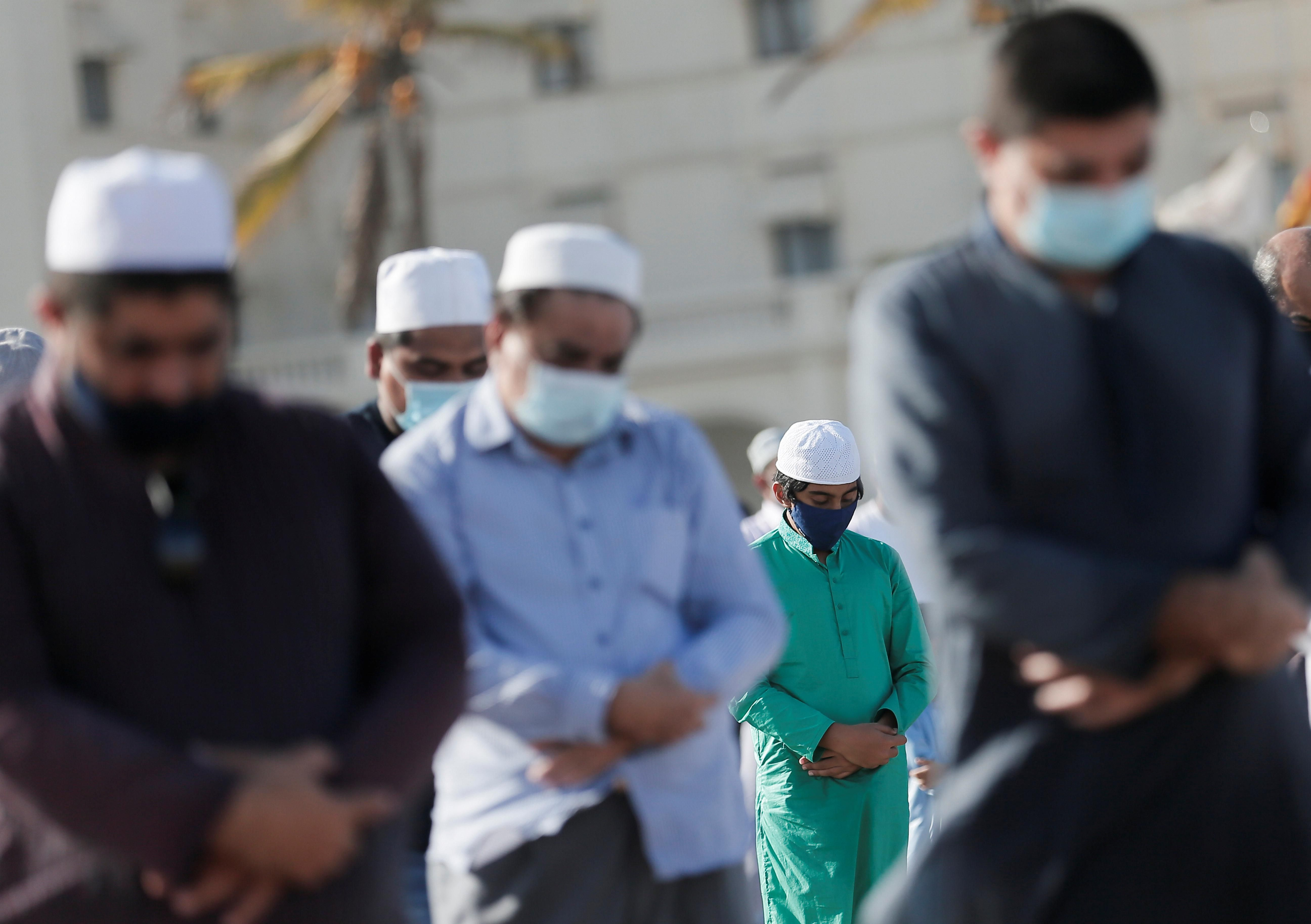 Muslims wearing protective masks practice social distancing as they attend a prayer to mark the Hajj festival, amid concerns about the spread of the coronavirus disease (COVID-19), in Colombo, Sri Lanka, August 1, 2020.