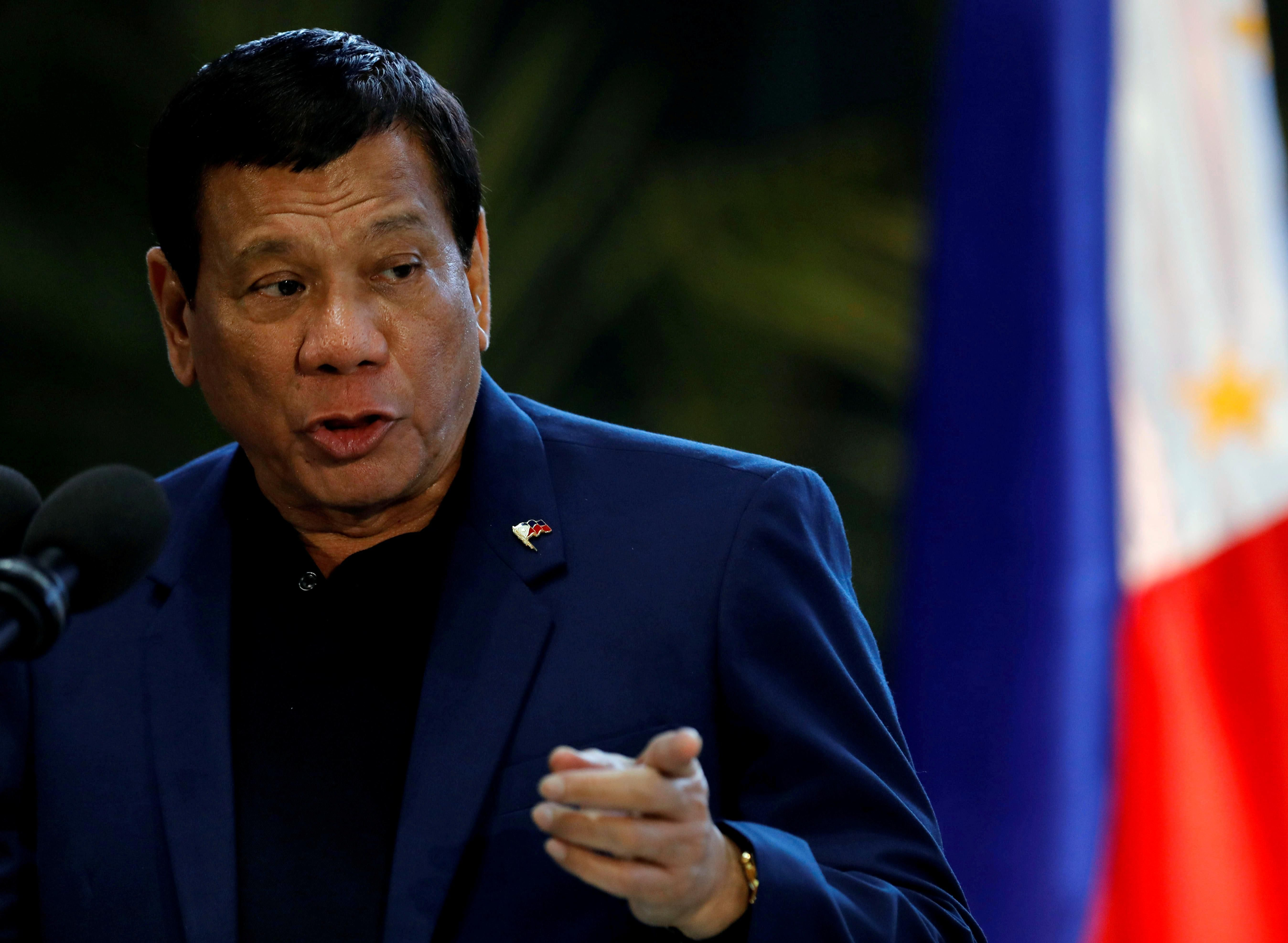 Philippine President Rodrigo Duterte speaks during a news conference at the Ninoy Aquino International Airport in Paranaque, Metro Manila, Philippines