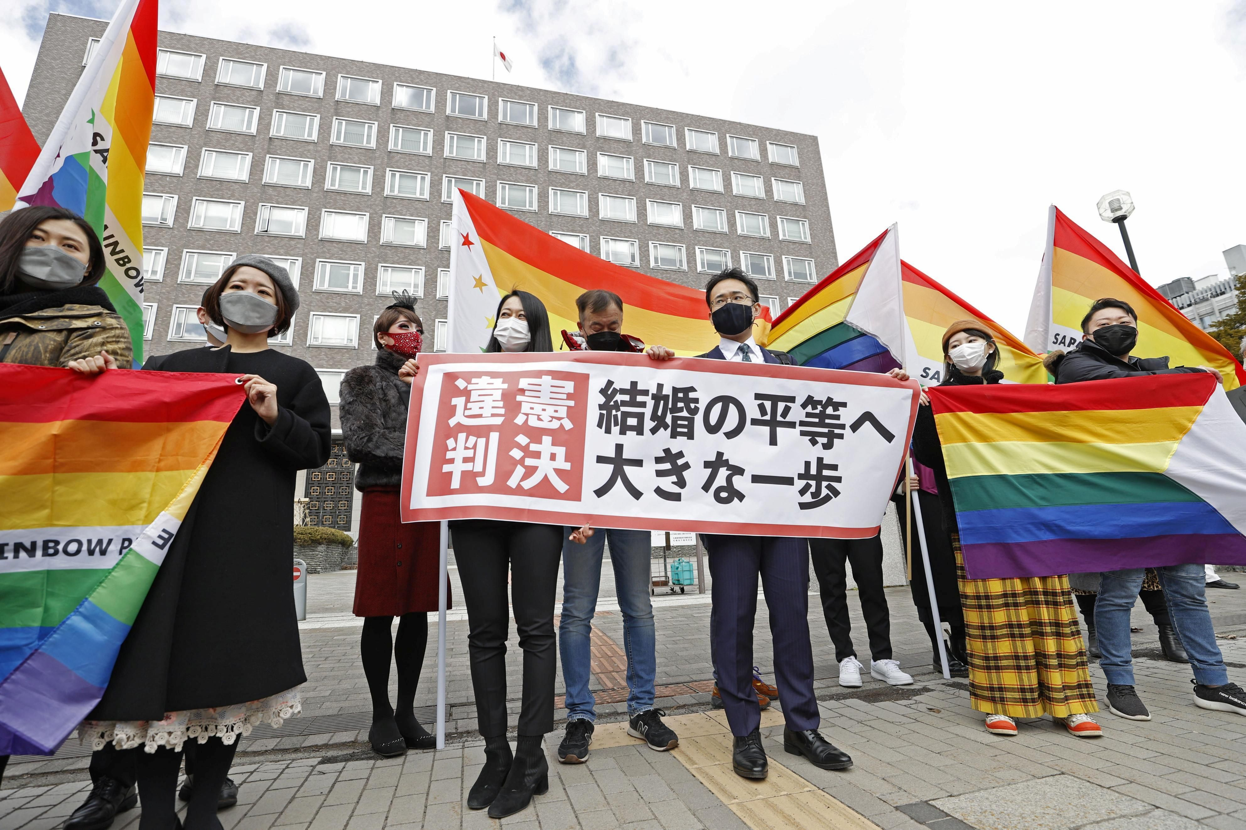 Plaintiffs' lawyers and supporters show a banner that reads 'Unconstitutional decision' after a district court ruled on the legality of same-sex marriages outside Sapporo district court in Sapporo, Hokkaido, northern Japan March 17, 2021