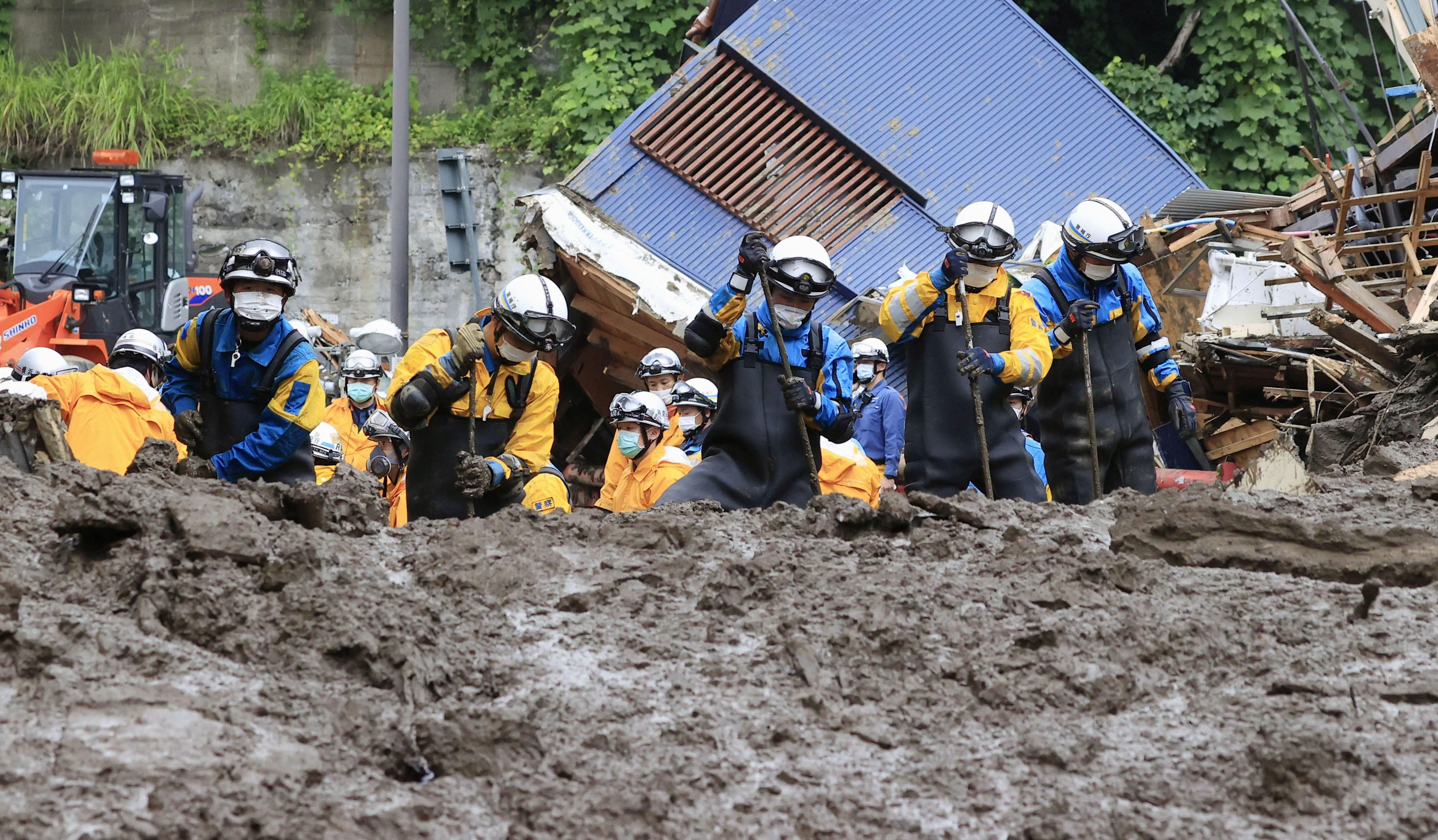 Police officers conduct a rescue and search operation at the site of a mudslide caused by heavy rain at Izusan district in Atami, Japan July 5, 2021, in this photo taken by Kyodo.
