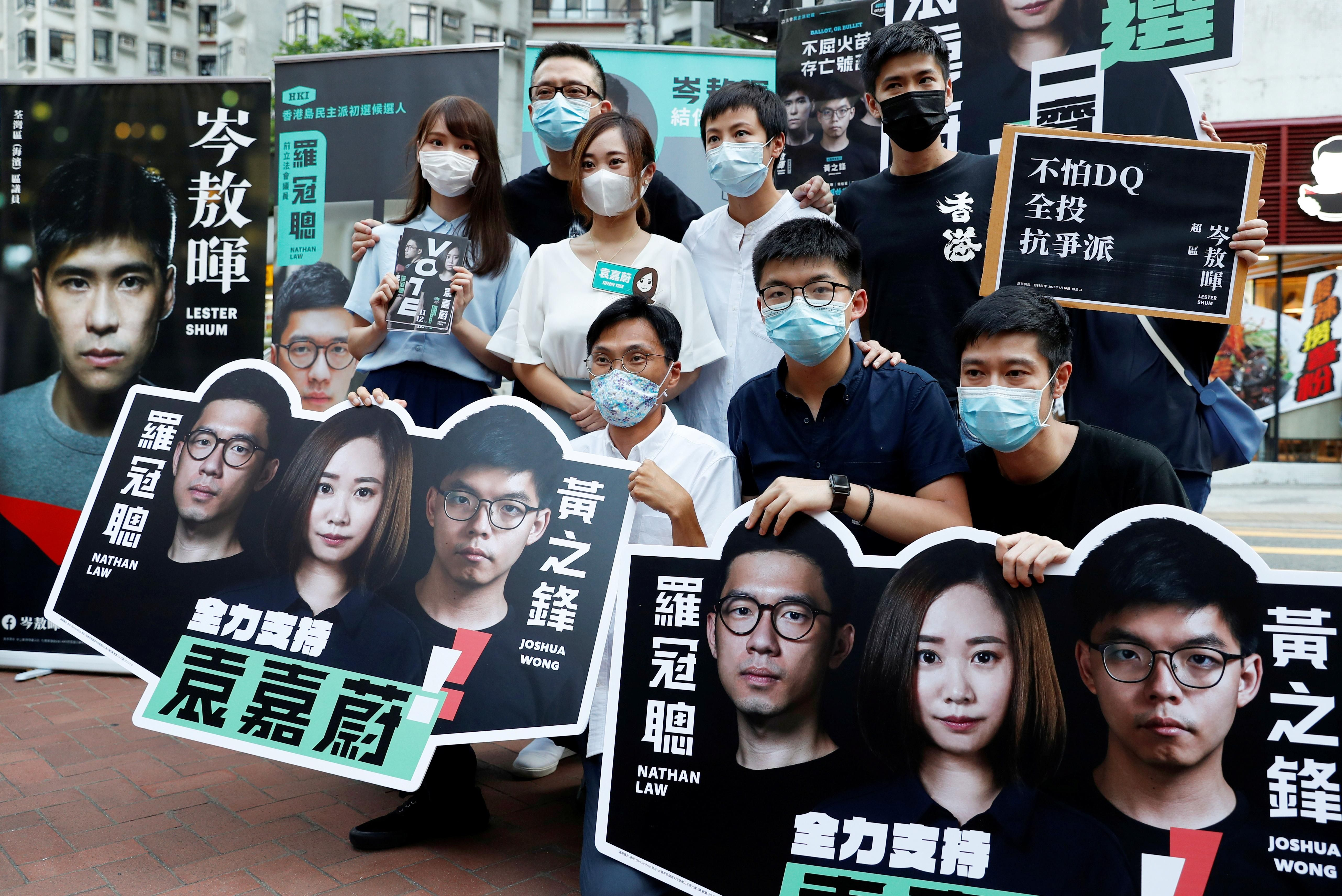 Pro-democracy activists campaigning during primary elections to select opposition candidates in Hong Kong, China. Reuters