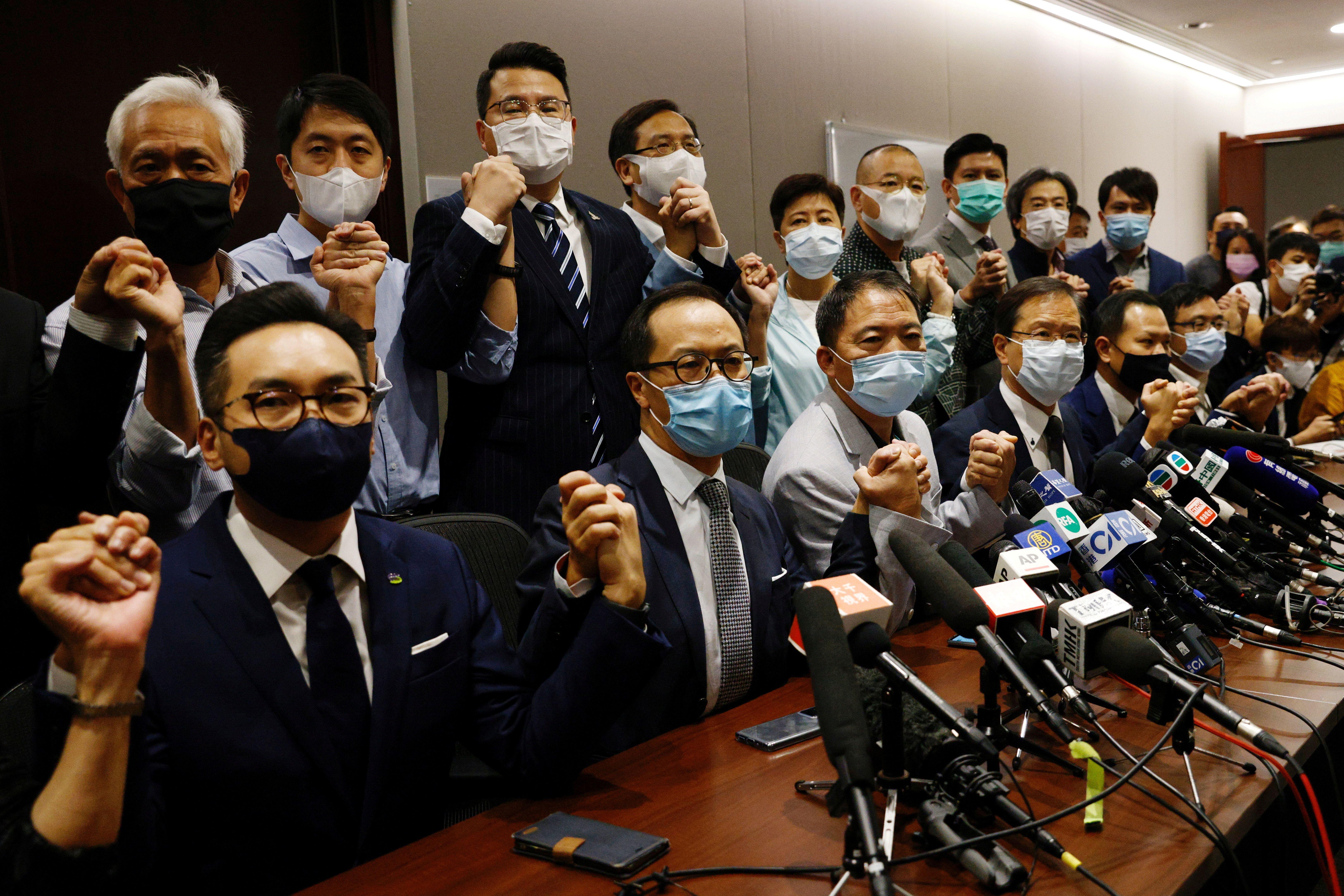 Pro-democracy legislators announce their resignation from the Legislative Council in Hong Kong. Reuters