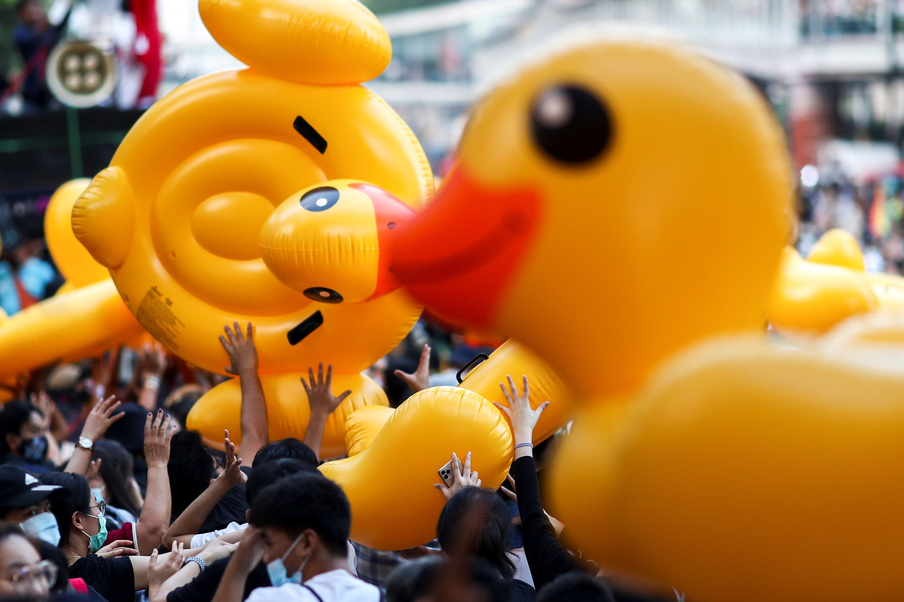 Pro-demonstrators carry inflatable rubber ducks during a rally in Bangkok. Reuters
