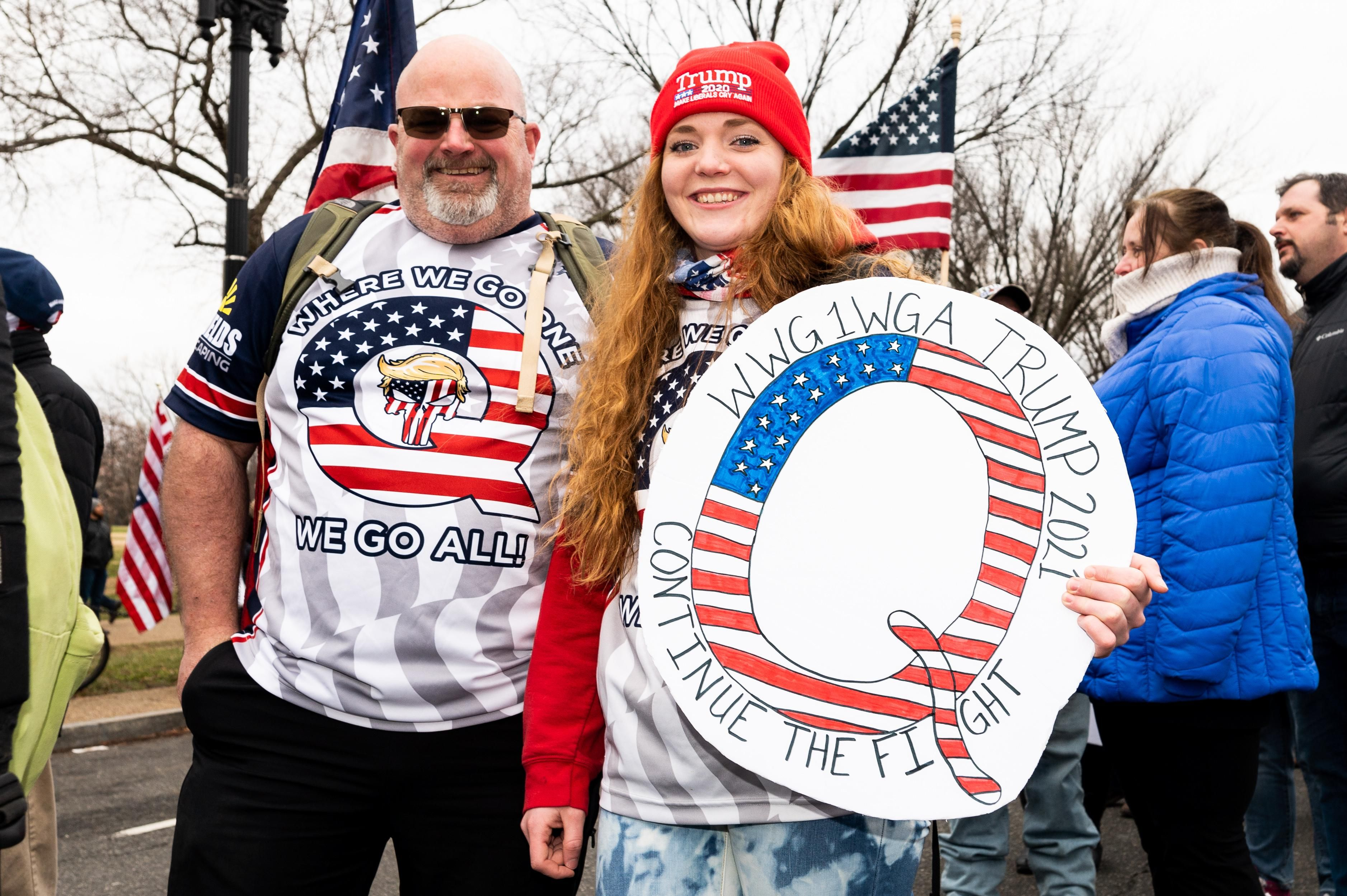 QAnon supporters attend a pro-Trump rally prior to the storming of the US Capitol building. Reuters