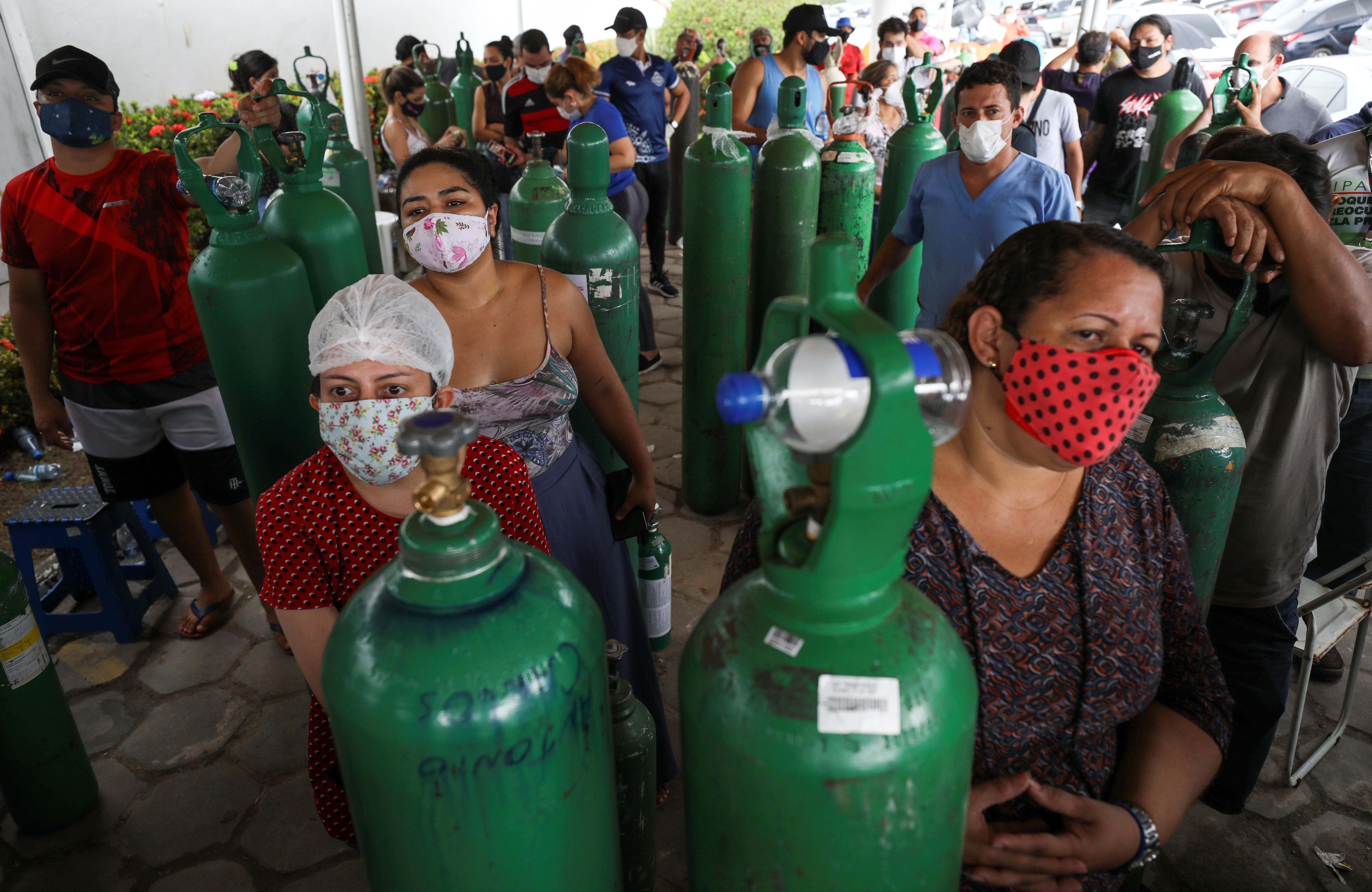 Relatives of COVID patients gather to buy oxygen in Manaus, Brazil. REUTERS/Bruno Kelly