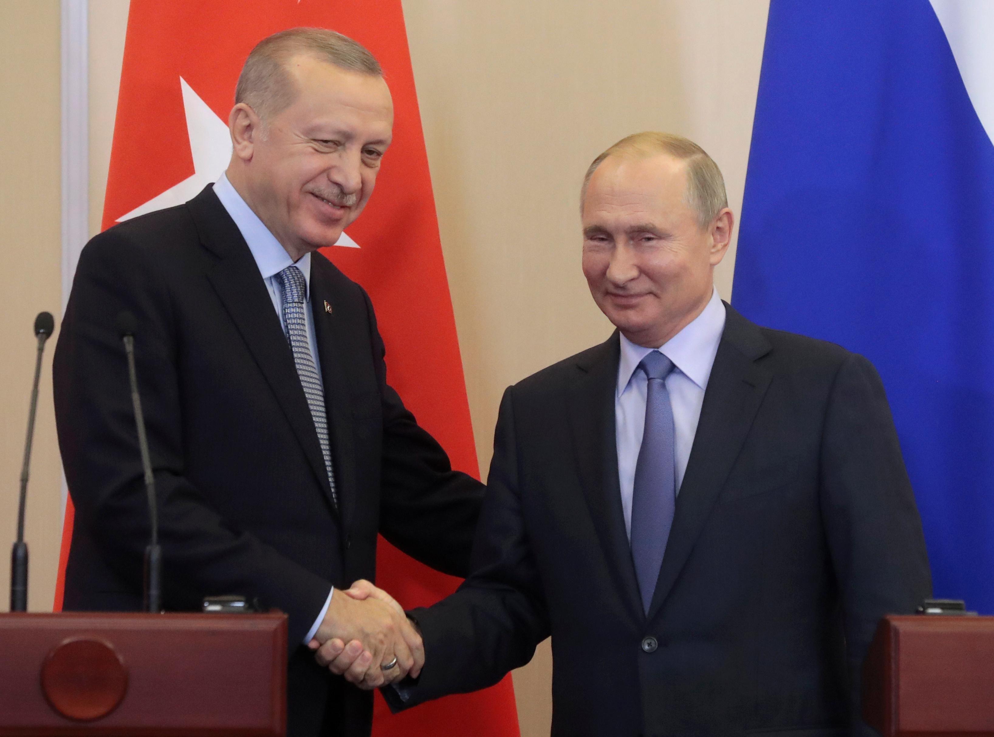 Russian President Vladimir Putin and Turkish President Recep Tayyip Erdogan shake hands during their joint news conference following Russian-Turkish talks in the Black sea resort of Sochi. Reuters