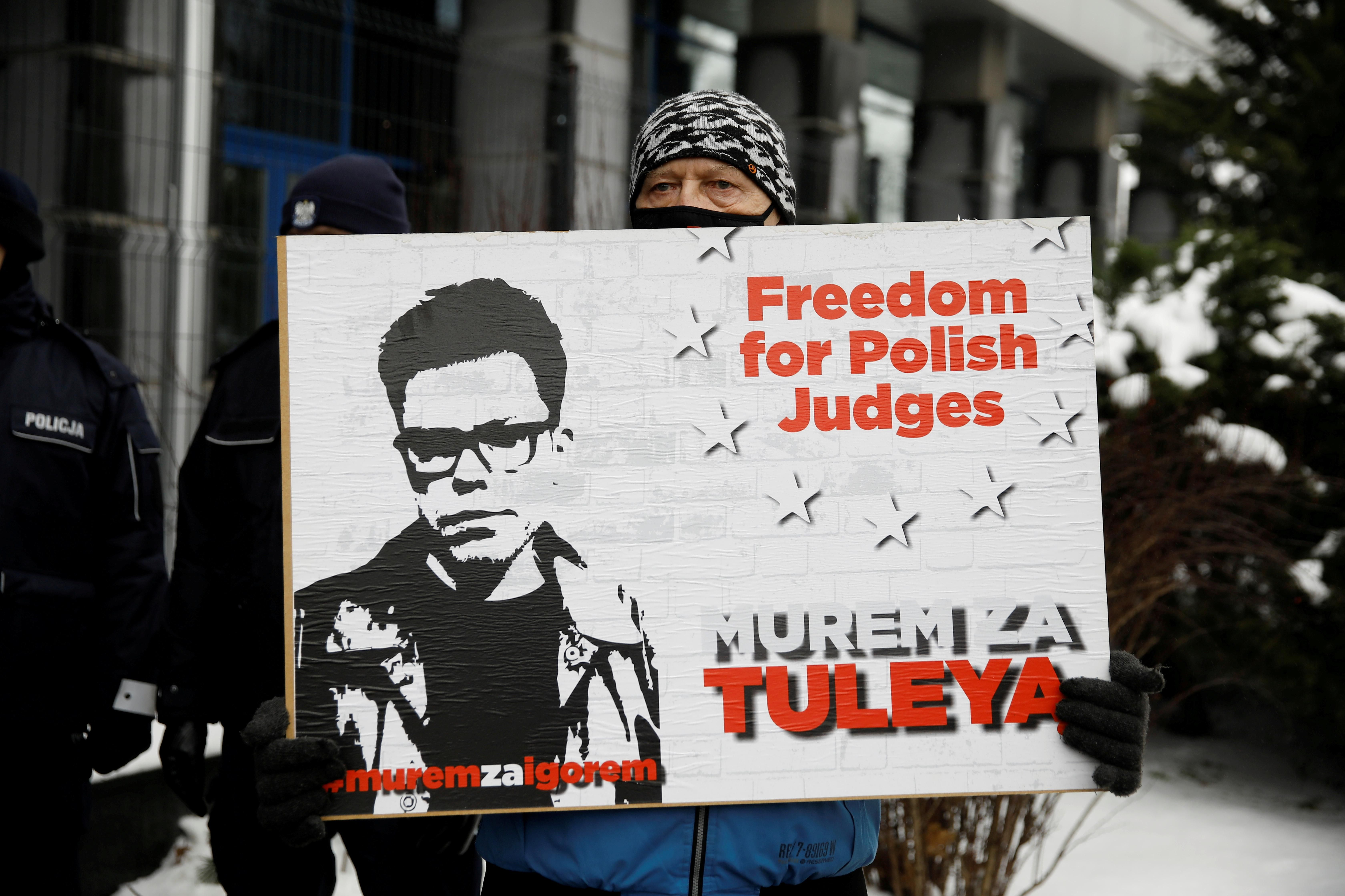 Supporter of Judge Igor Tuleya stands with a banner in front of the National Public Prosecutor's Office in Warsaw, Poland January 20, 2021.