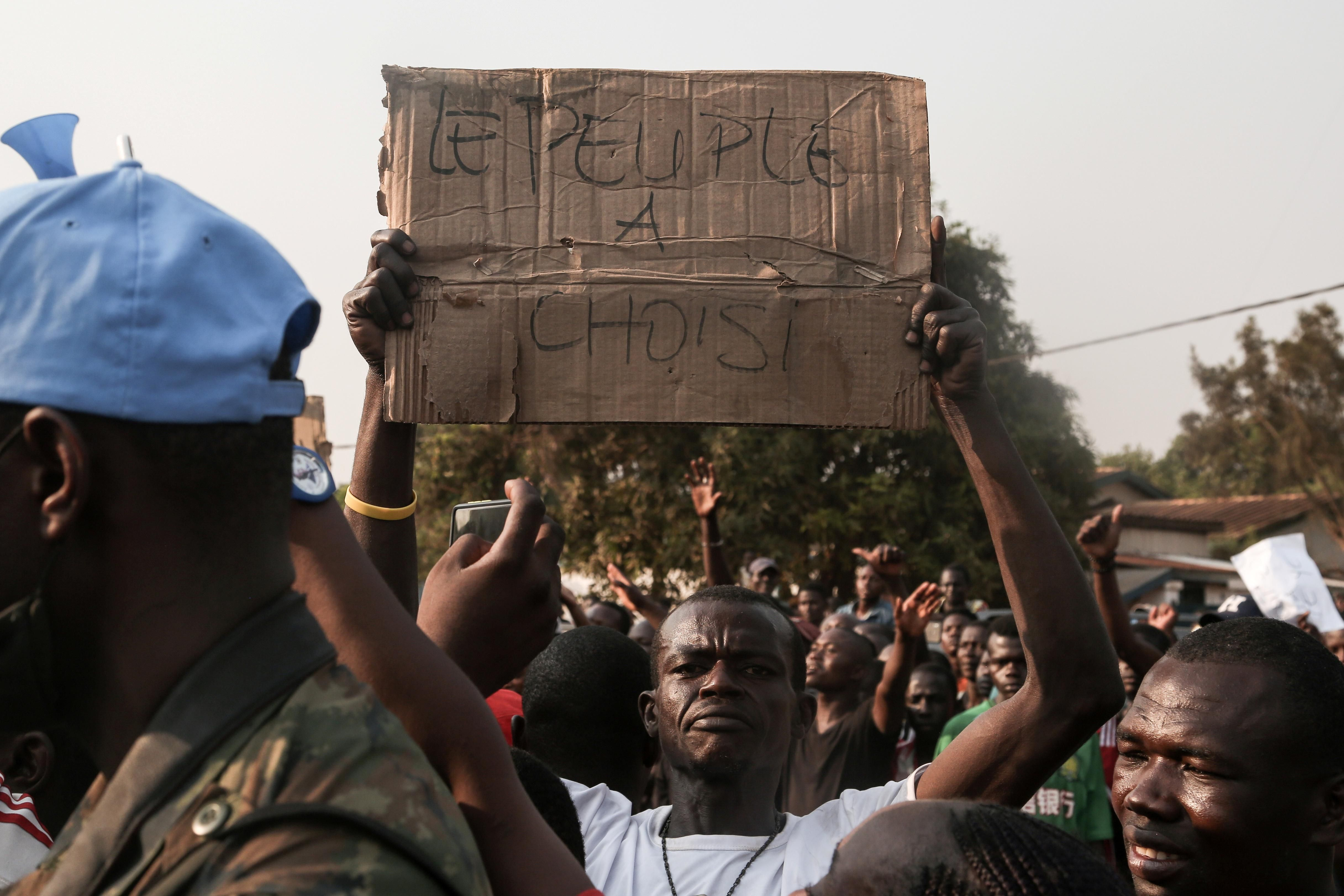 Supporters of CAR President Faustin-Archange Touadera celebrate after the high court confirms his reelection in the capital, Bangui. REUTERS/Antoine Rolland