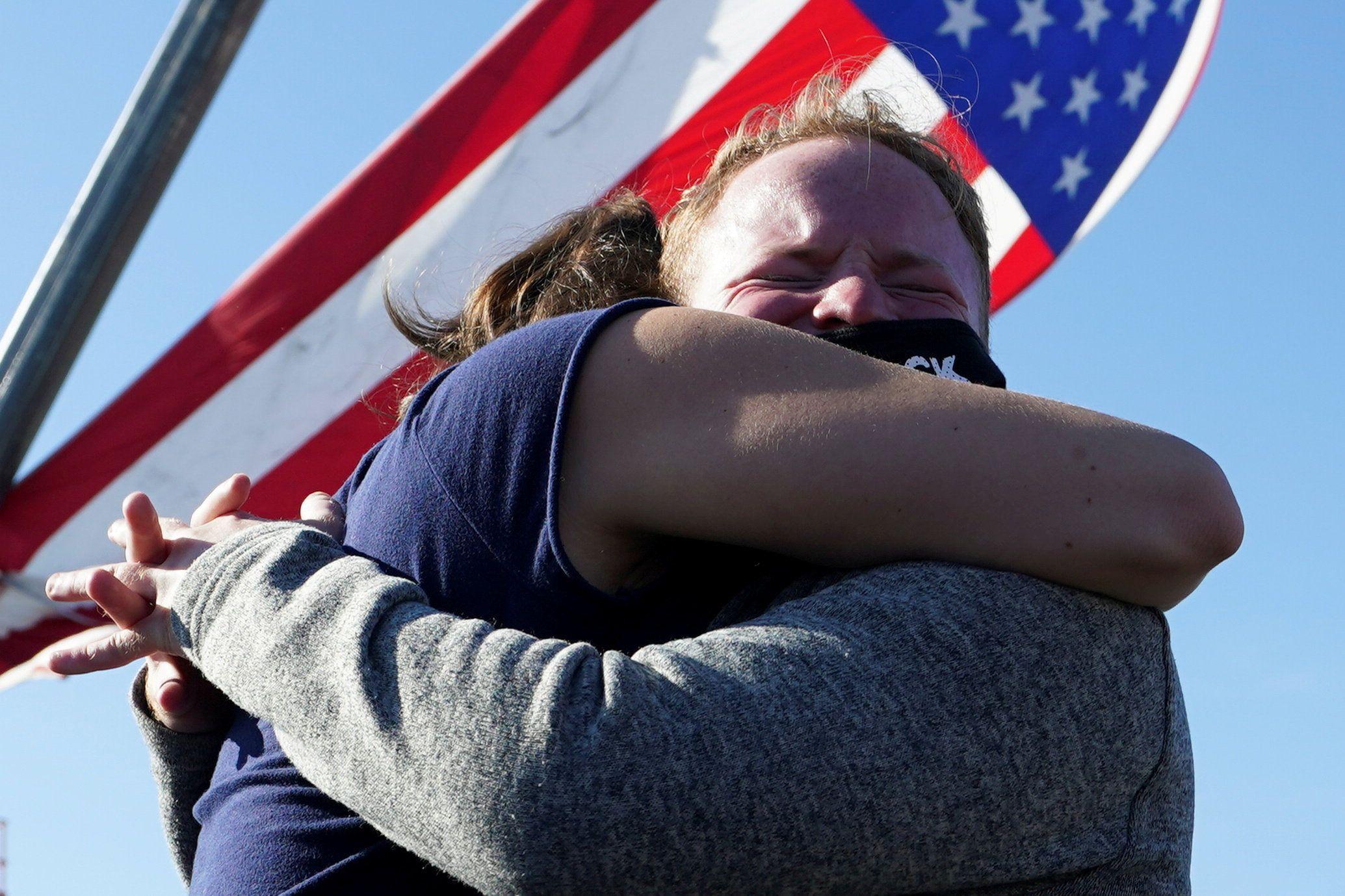 Supporters of Democratic U.S. presidential nominee Joe Biden embrace