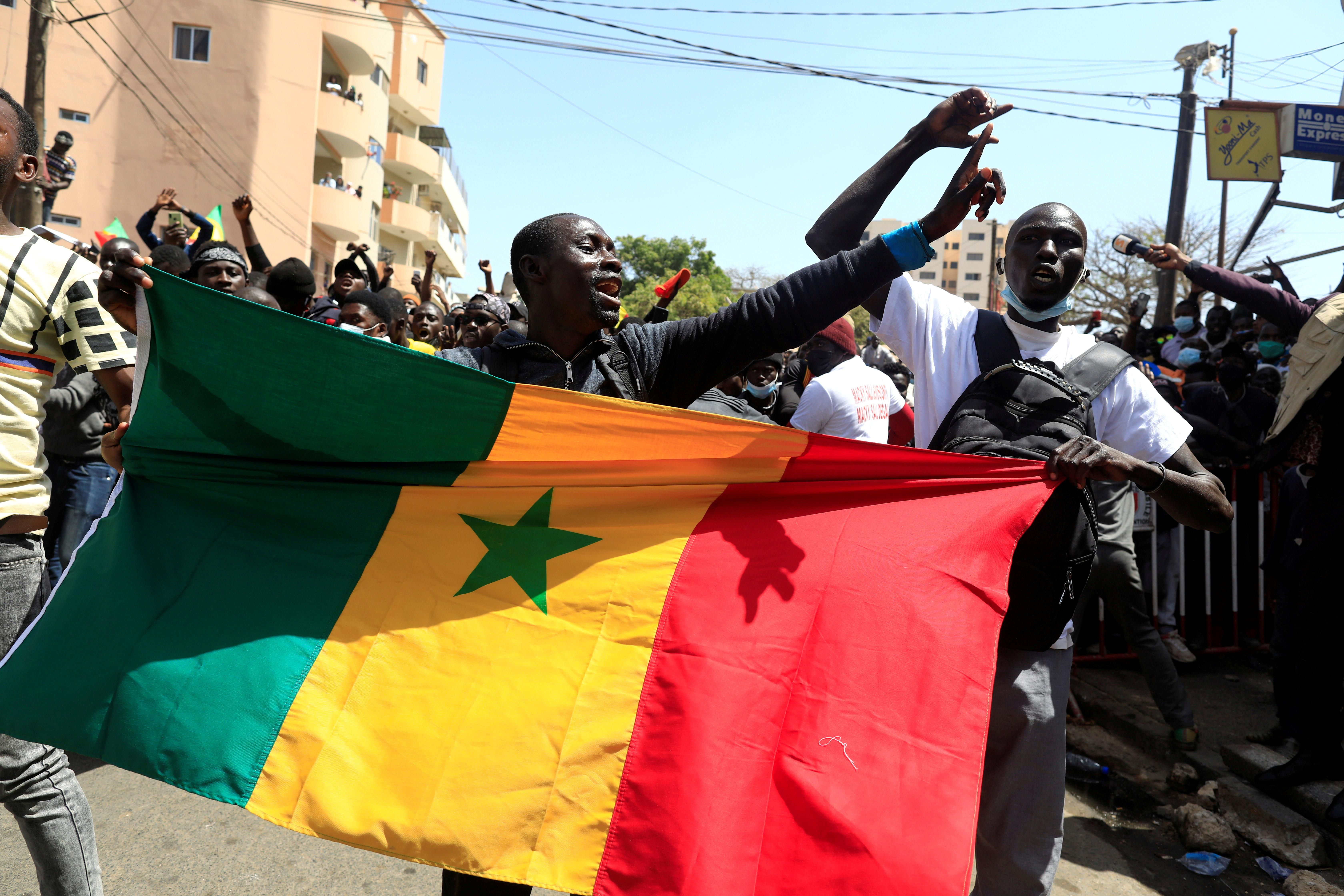 Supporters of opposition leader Ousmane Sonko, who was indicted and released on bail under judicial supervision, attend a demonstration in front of the court in Dakar, Senegal March 8, 2021