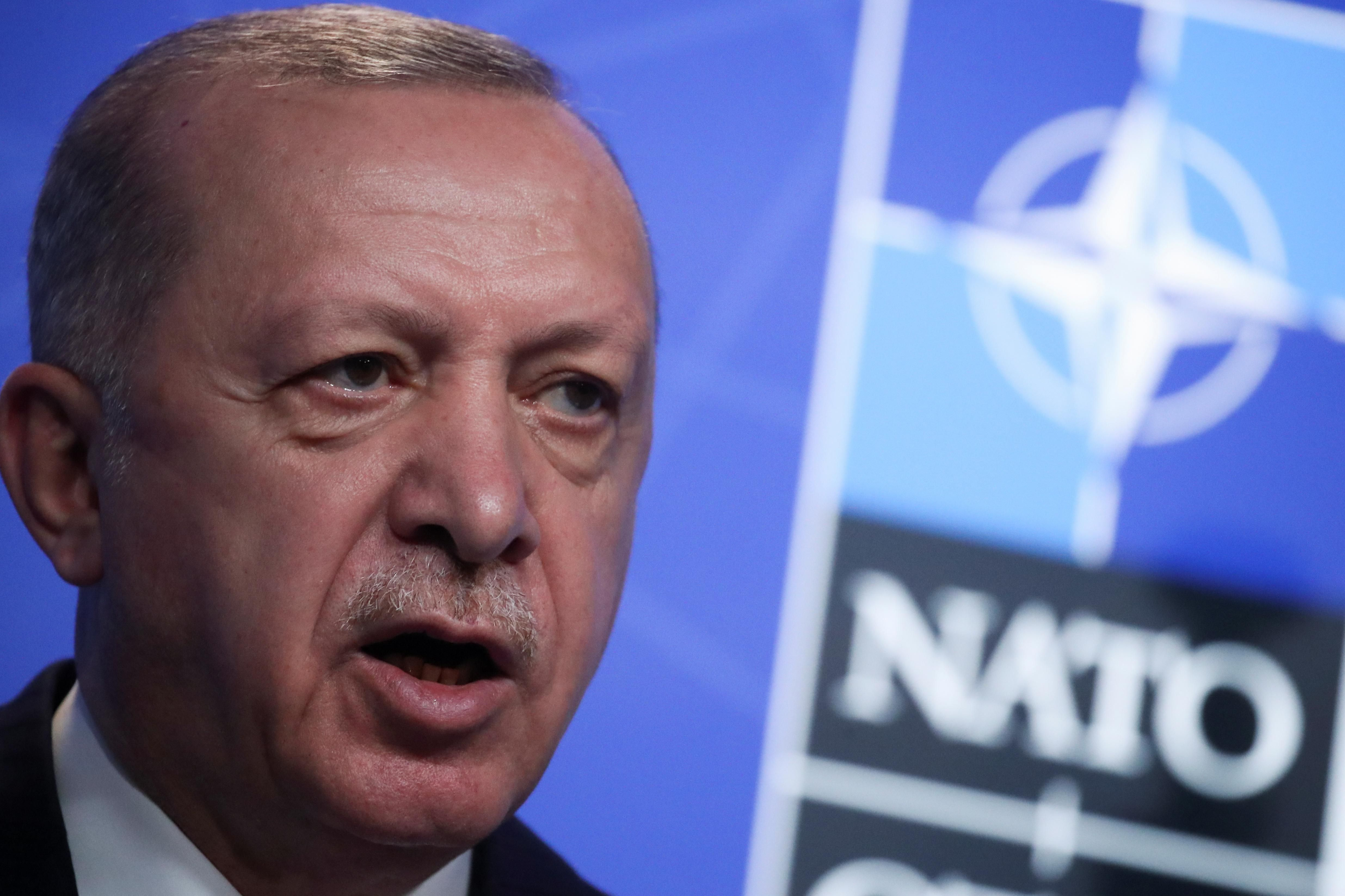 Turkey's President Tayyip Erdogan holds a news conference during the NATO summit at the Alliance's headquarters in Brussels, Belgium June 14, 2021