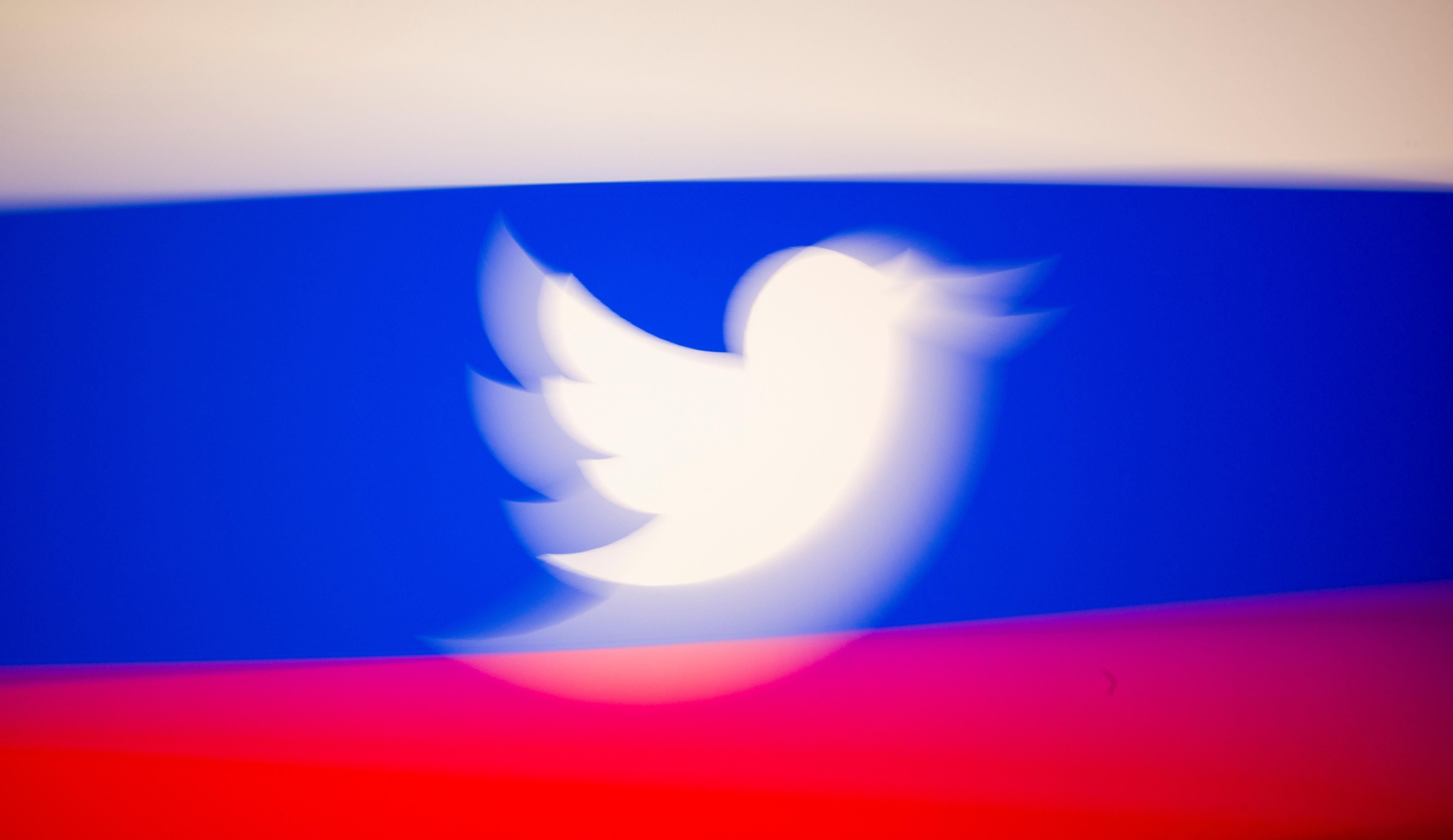 Twitter logo and a Russian flag.