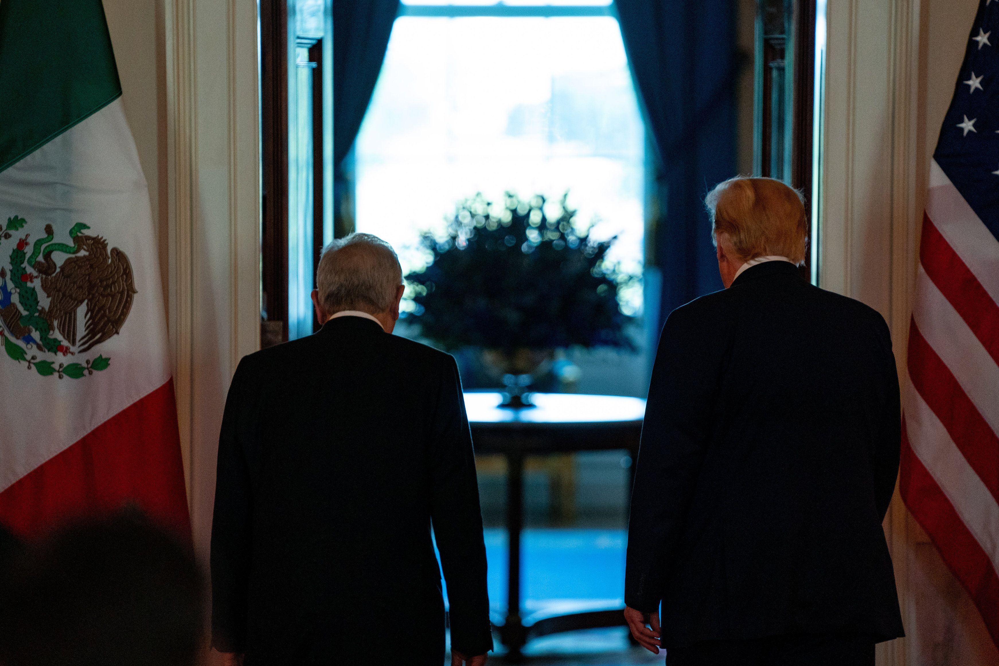 U.S. President Donald Trump and Andres Manuel Lopez Obrador, Mexico's president, depart during a news conference in the Cross Hall of the White House in Washington, D.C., U.S., on Wednesday, July 8, 2020.
