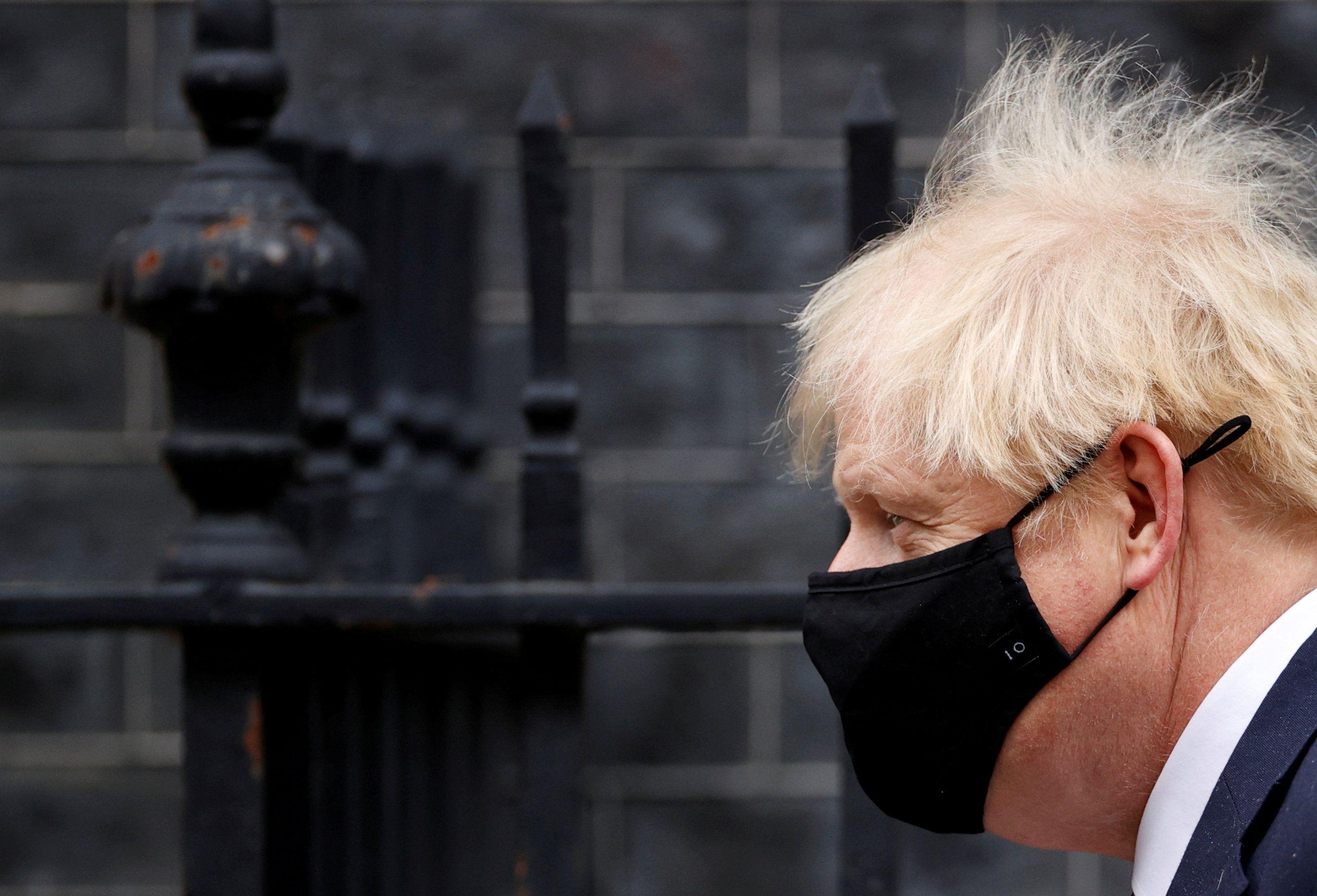 UK Prime Minister Boris Johnson wearing a mask