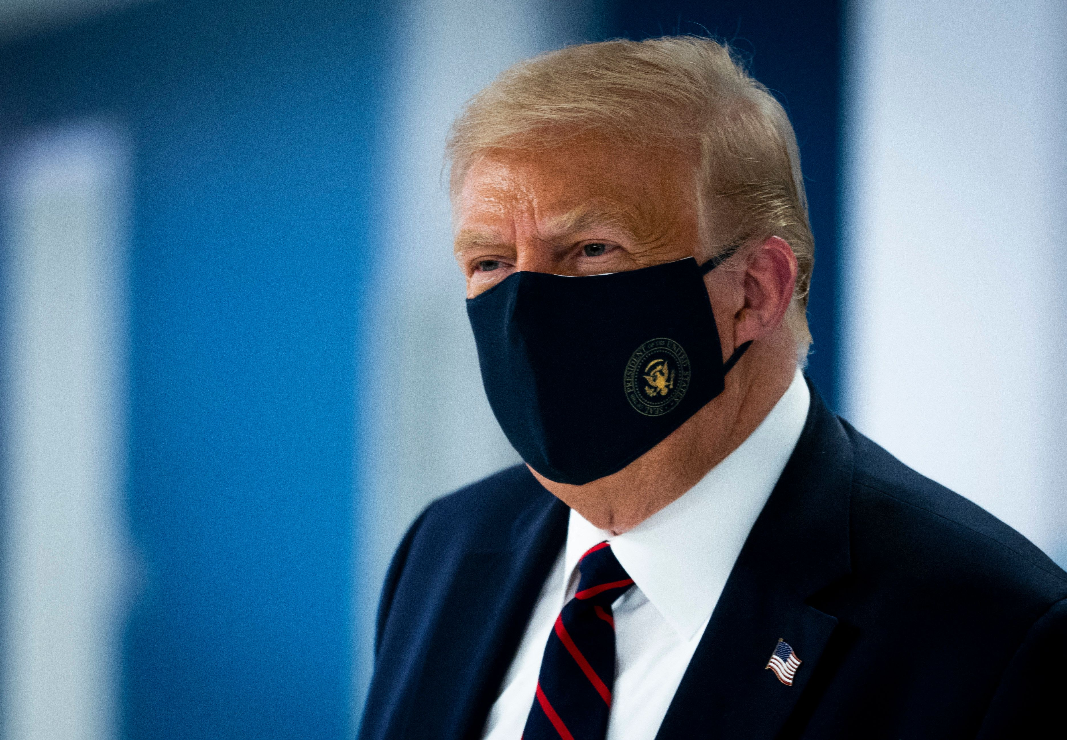 US President Donald Trump wearing a face mask against COVID-19. Reuters