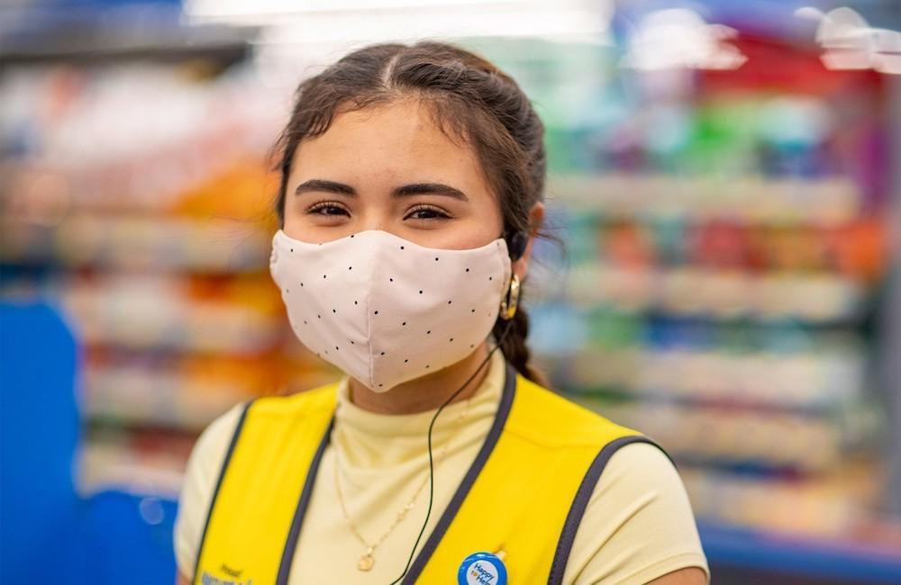 Walmart employee looking at camera, wearing a mask